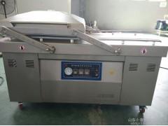 供应山东小康牌DZ-700/2S型烧鸡全自动真空包装机