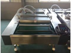 供应小康牌DZ-1000滚动式真空包装机/大包装专用