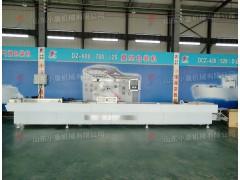 厂家直销山东小康牌冷冻调理品全自动连续拉伸膜真空包装机价格